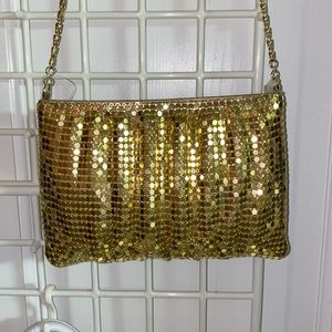 Gold evening bag with gold chain. New